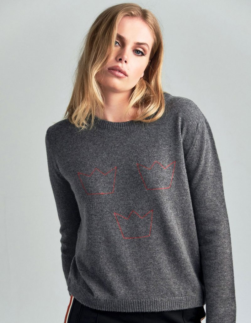 Studio image of a woman in cashmere knitwear, a malin darlin Three Crowns cashmere jumper.