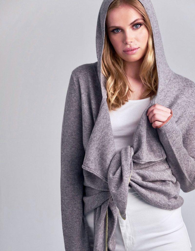 Studio photo of model in designer knitwear, the malin darlin cashmere tie hoody.