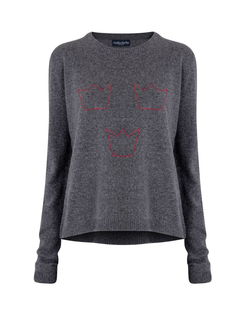 A grey designer cashmere jumper with three red crowns knitted into the pattern.