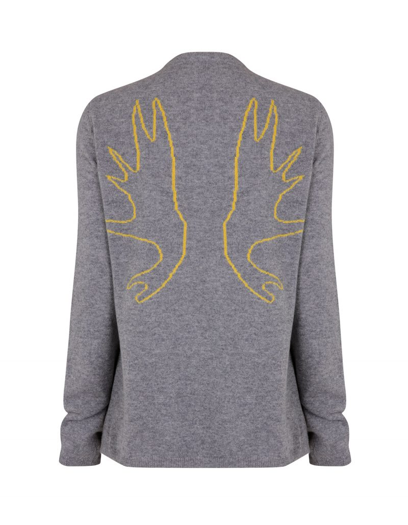 Studio image of the Malin Darlin cashmere jumper showing the antlers design knitted into the pattern.