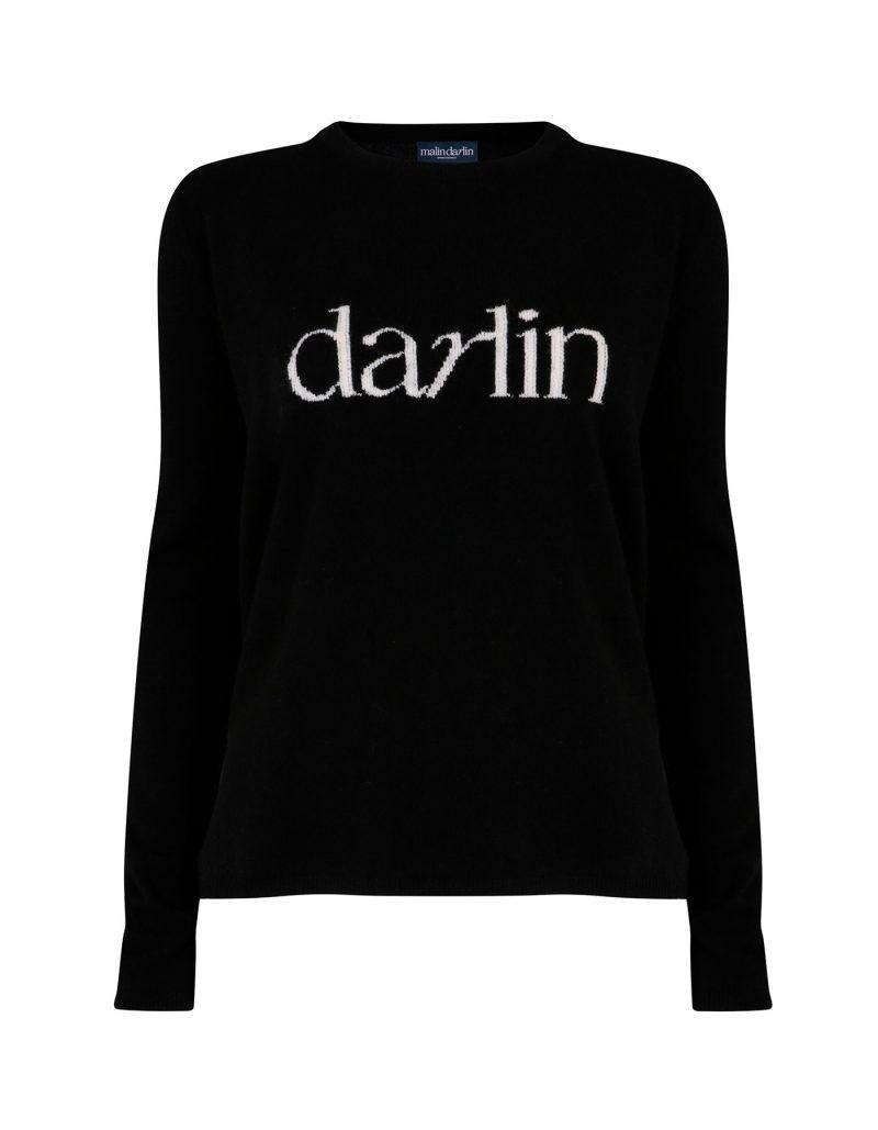 The malin darlin Darlin black cashmere jumper pictured against a white background.