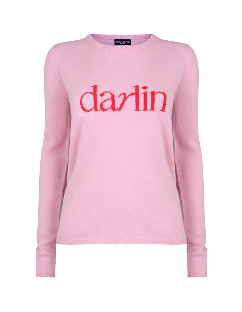 Photo of the malin darlin Darlin Pink designer cashmere jumper isolated on white.