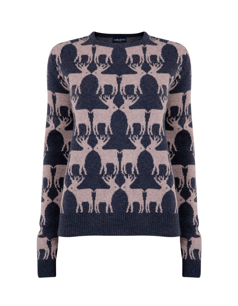Image of a cashmere jumper with navy reindeers knitted into the design.