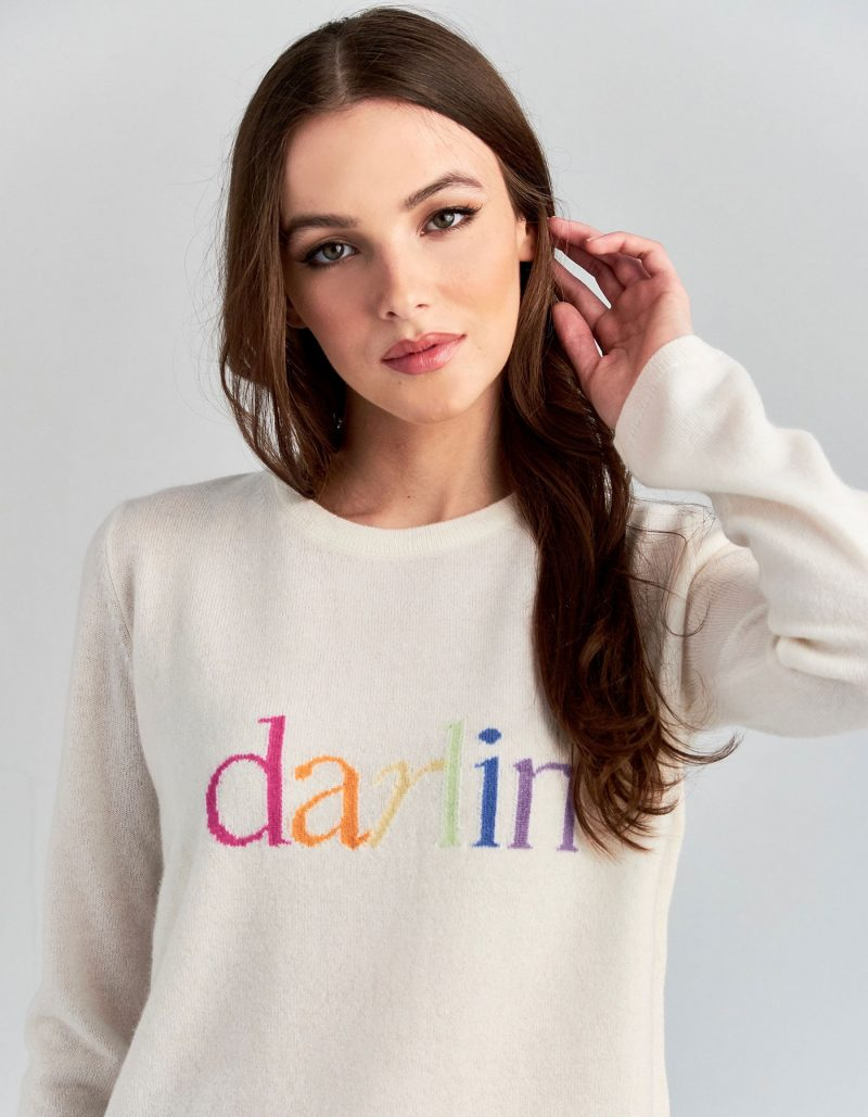 A model wearing darlin pastel cashmere knitwear, one of the signature styles in malin darlin womens jumpers.