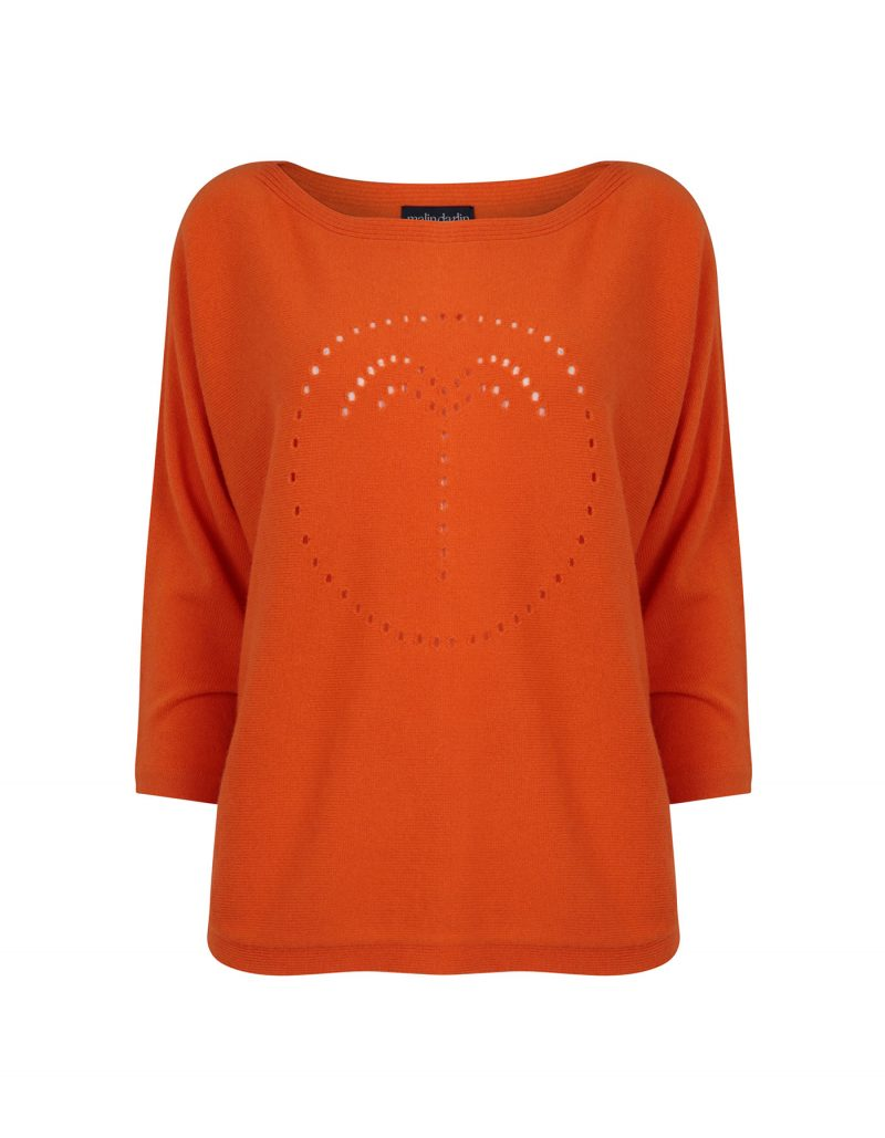 Photo of a palm jumper in orange, part of the malin darlin range of designer cashmere jumpers, on a white background.