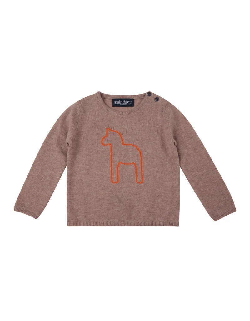 The malin darlin Baby Pony beige kids cashmere jumper pictured flat on a white backdrop.