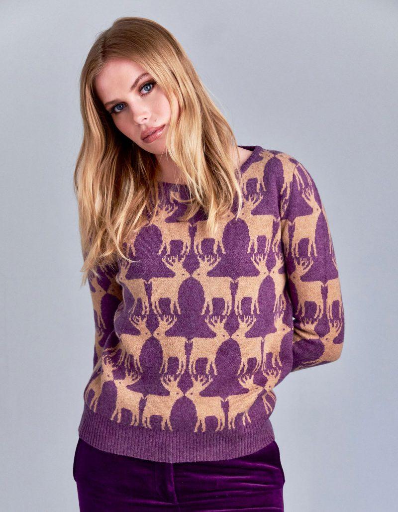 Purple ad beige designer cashmere jumpers with reindeer patterning.