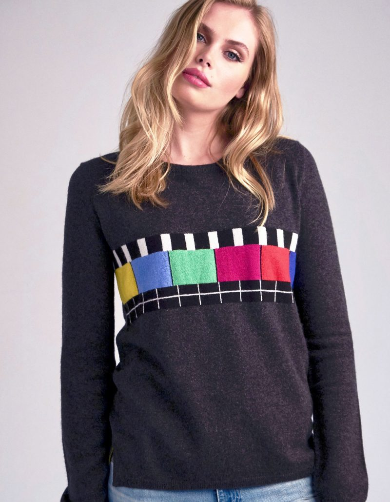 Multi-colour pattern on a charcoal grey cashmere jumper.