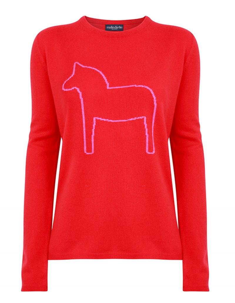 Photograph of malin darlin Dalahast horse cashmere jumpers, a pony depicted on red cashmere, against a white background.