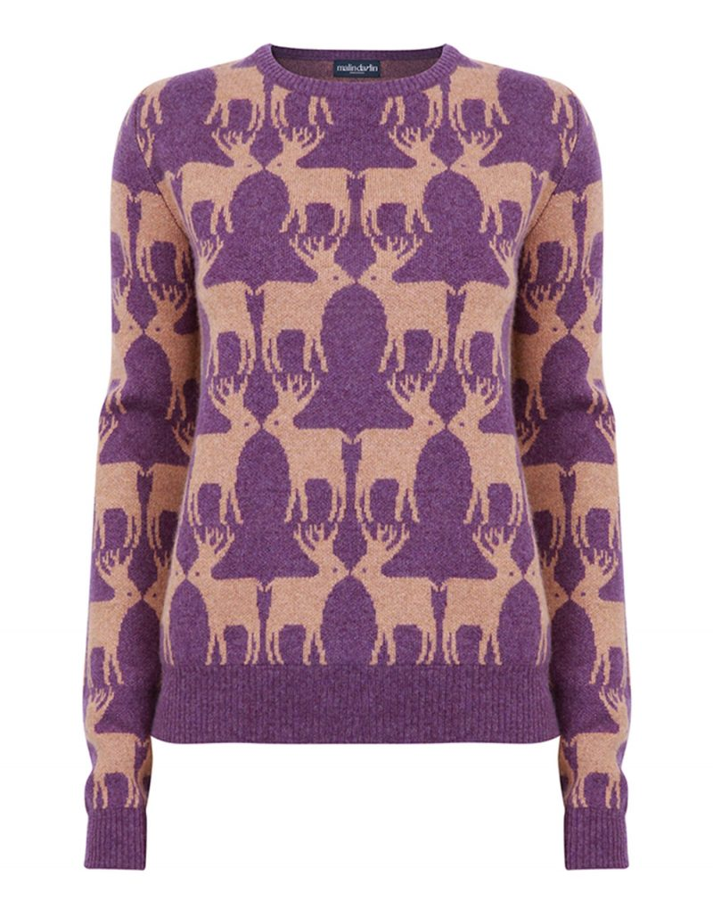 Cashmere knitwear, a malin darlin Reindeer purple cashmere jumper, laid flat on a white background.