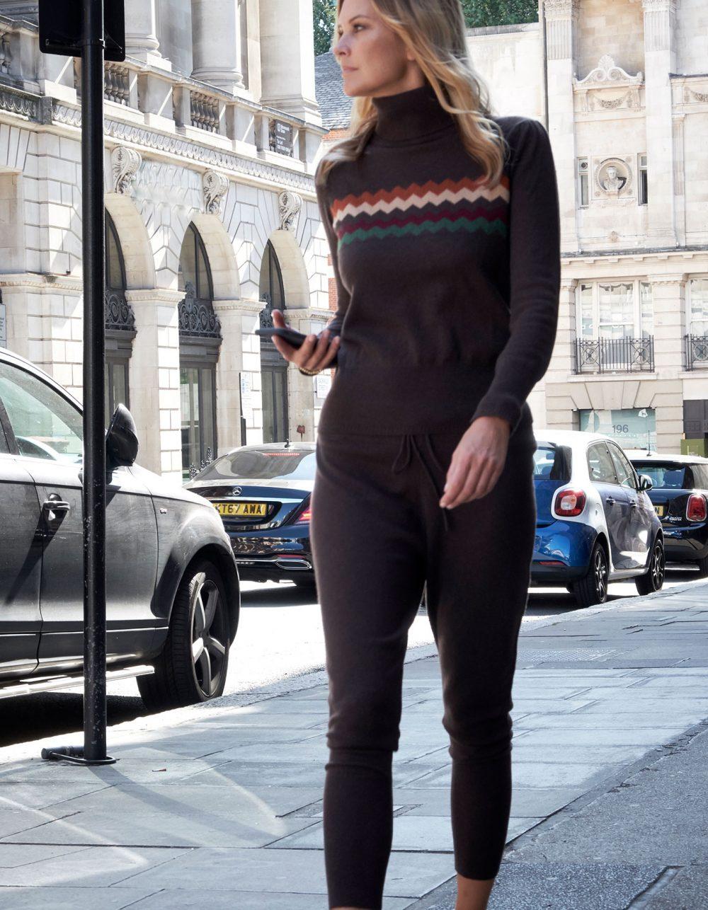 Model walking on a city street, wearing malin darlin designer womens cashmere sweatpants.
