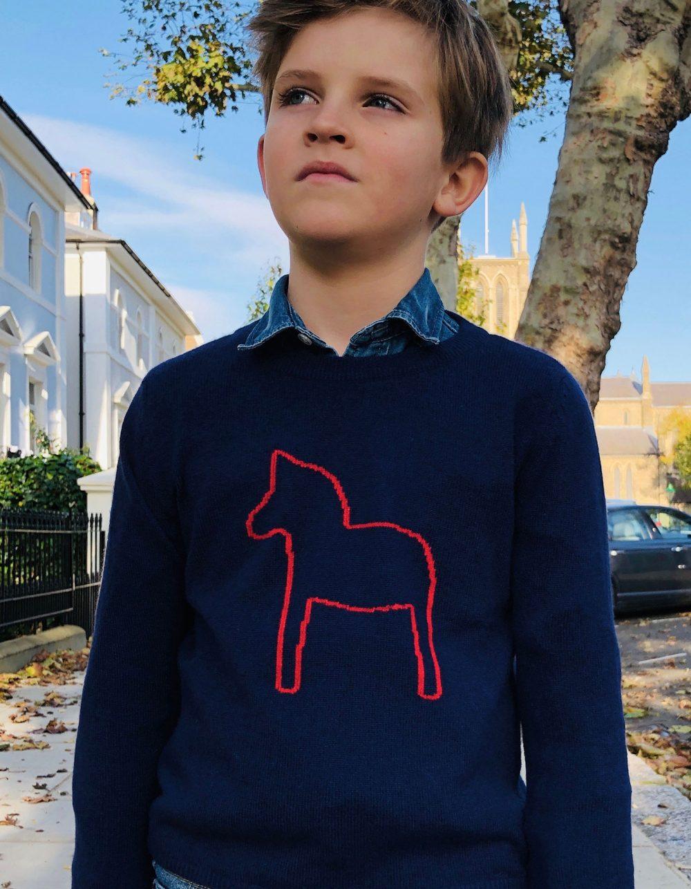 Boy wearing childrens cashmere, the malin darlin Little Pony Navy cashmere jumper.
