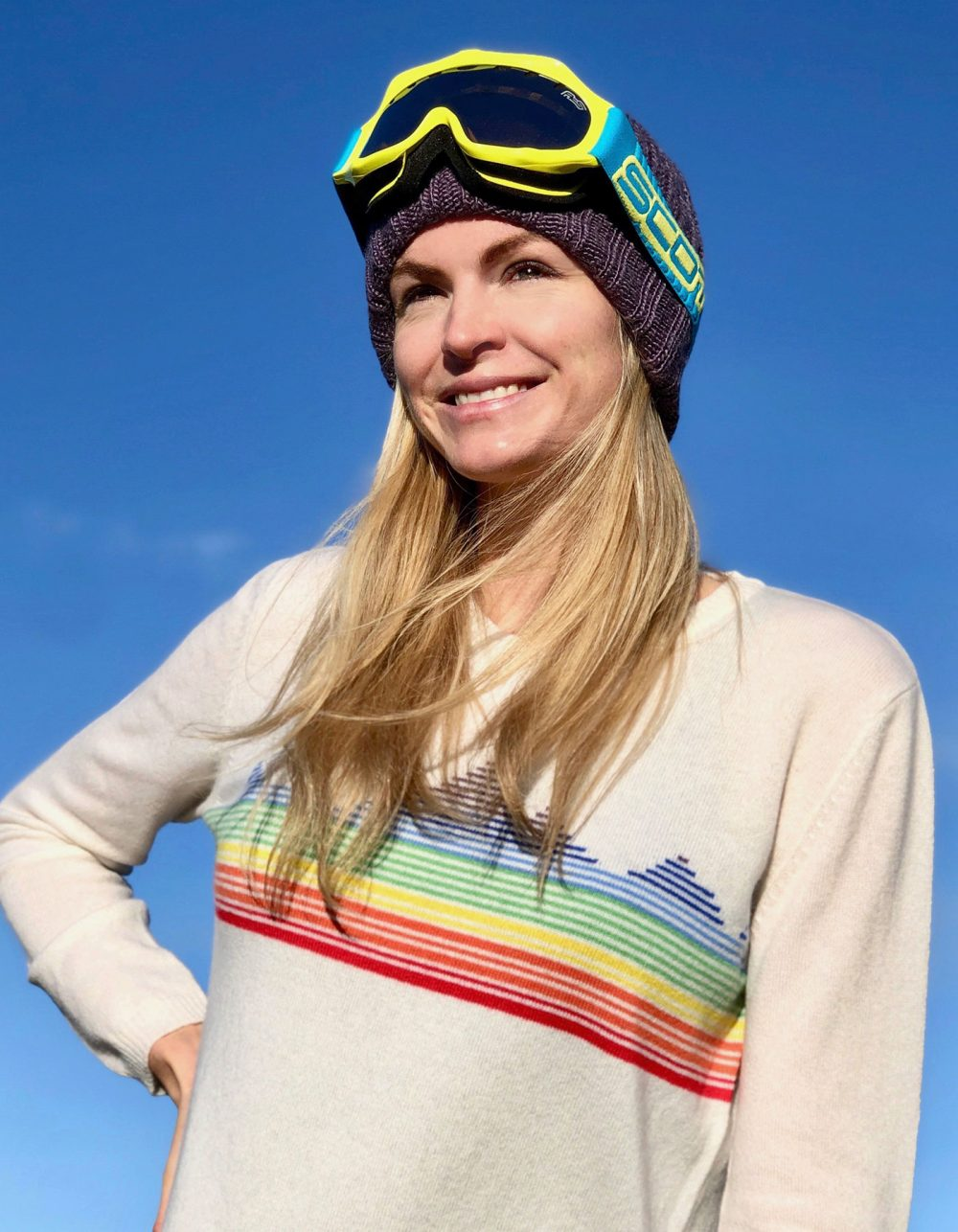 Woman in a Rainbow Mountain jumper to promote lady kilas charities designer cashmere jumpers at malin darlin.