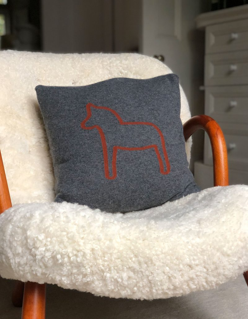 Image of a grey designer cashmere cushion cover, part of the malin darlin range of cashmere gifts.