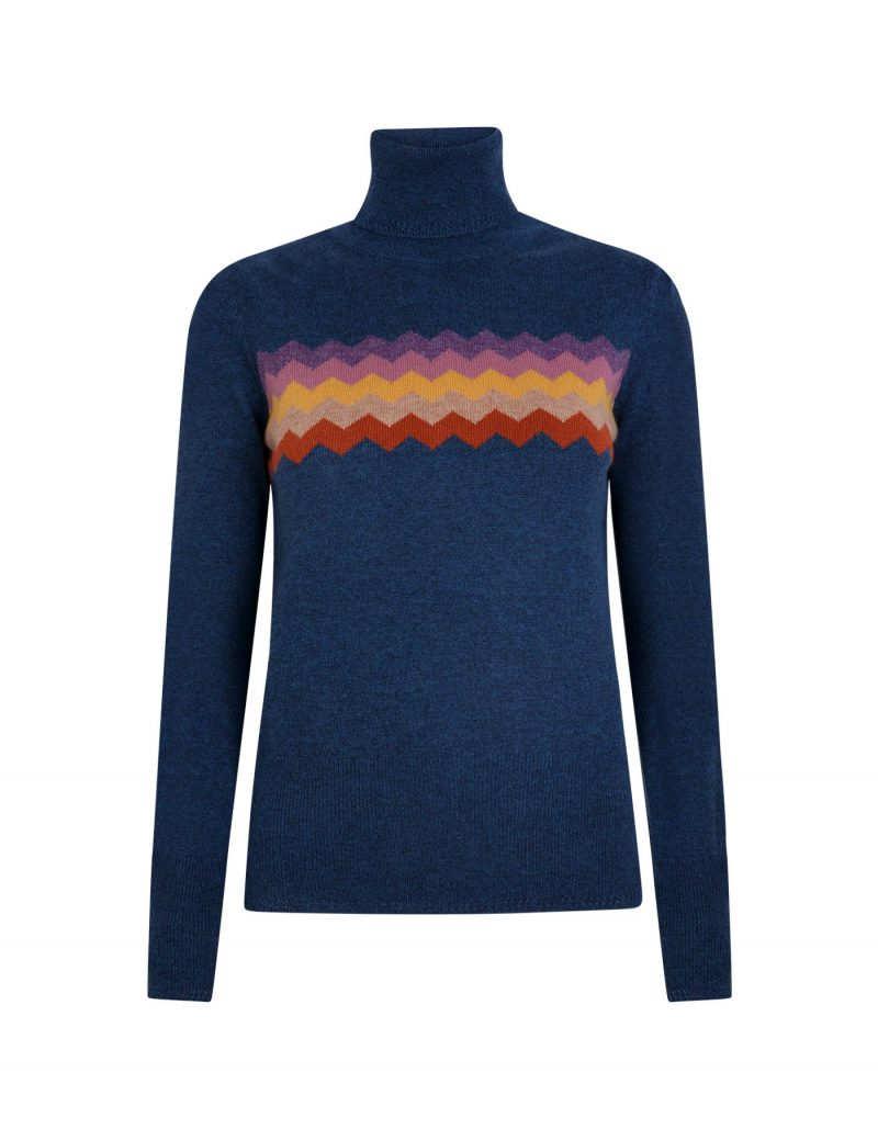 A blue cashmere jumper with a multi-coloured Zigzag pattern on the front.