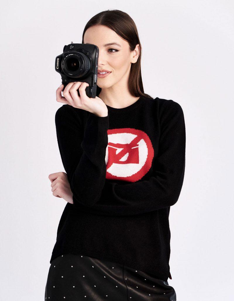 Camera photograph design on black cashmere jumpers.