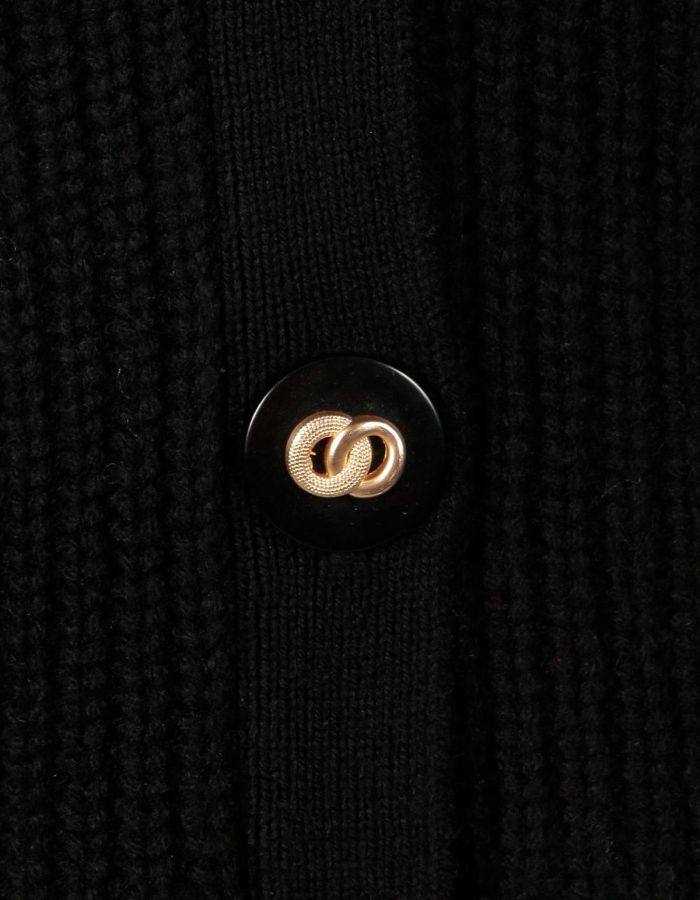 Button detail, two gold rings entwined, on a malin darlin black Coco rib wool and cashmere cardigan.
