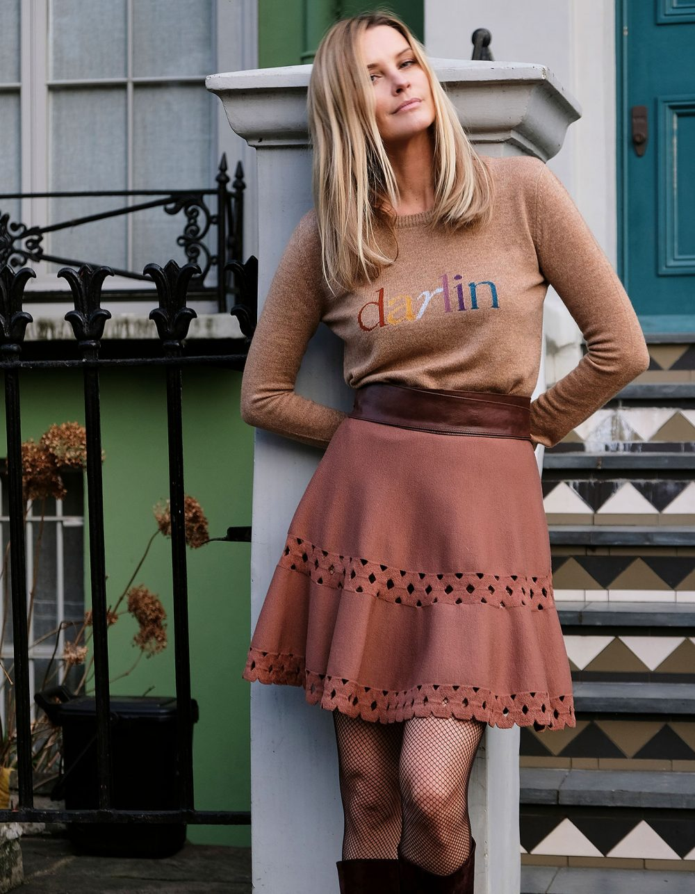Model leaning against a pillar outside a London townhouse wearing the womens cashmere Darlin Beige jumper.