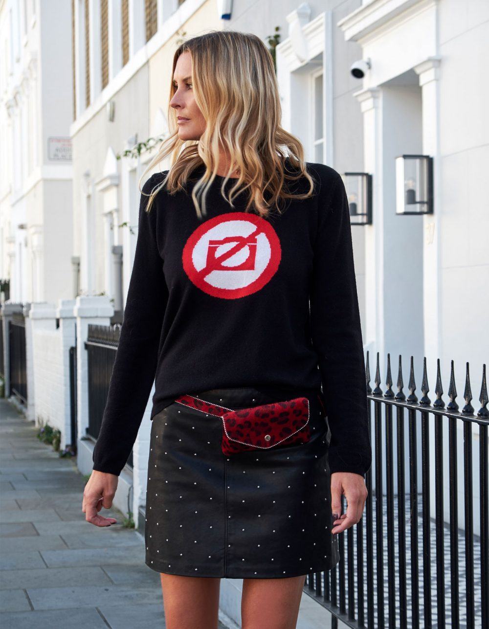 Model on a London street dressed in malin darlin designer cashmere, the No Photos black cashmere jumper.