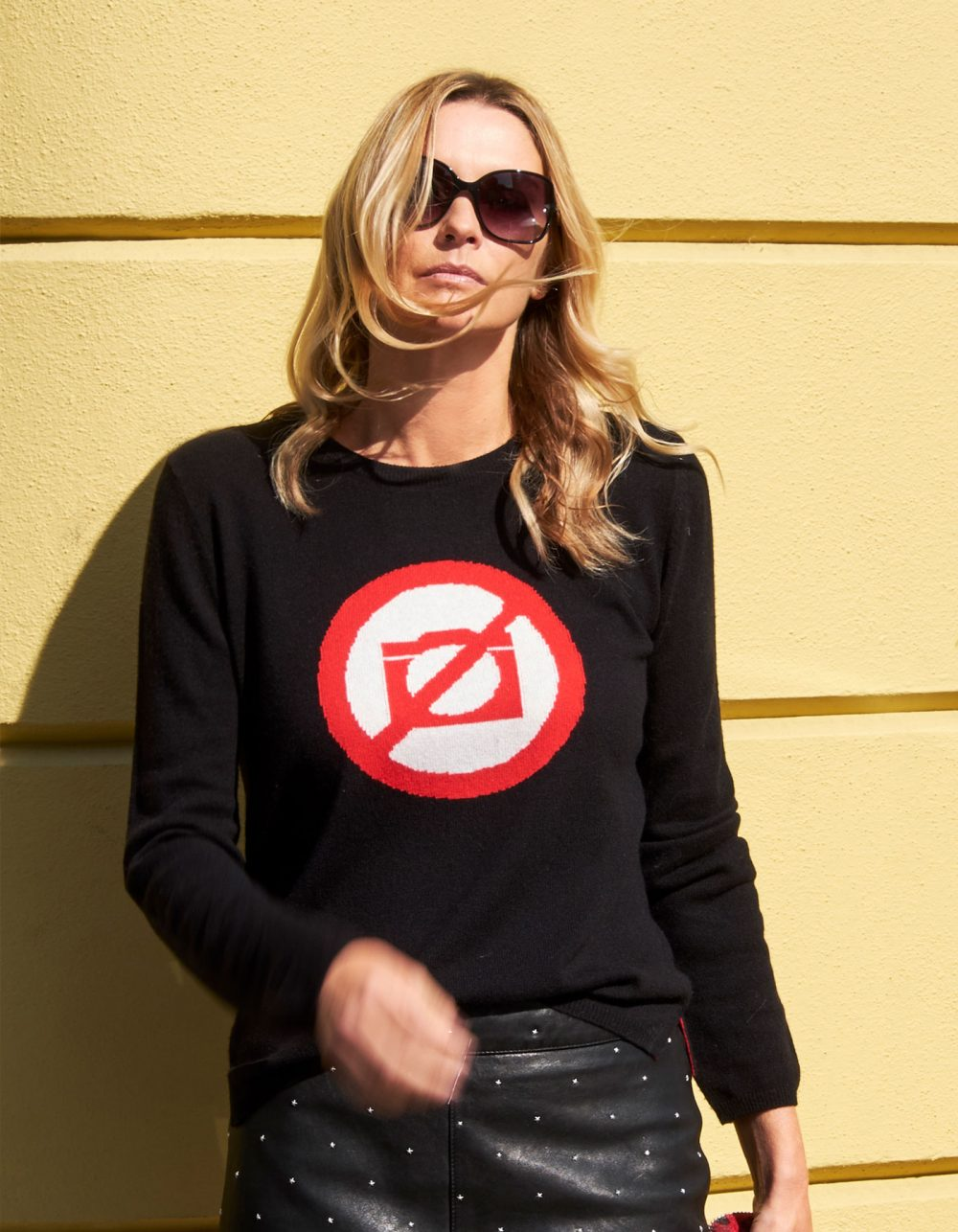 Woman in shades wearing malin darlin designer cashmere, the No Photos black cashmere jumper.