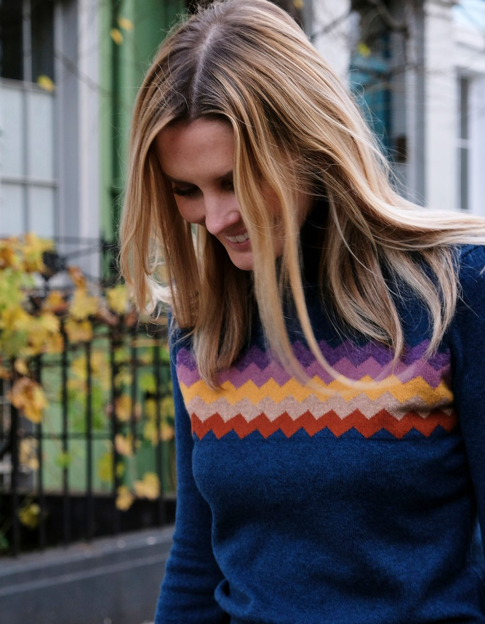 Close up of a smiling woman in malin darlin cashmere knitwear, the Zigzag Blue cashmere jumper.
