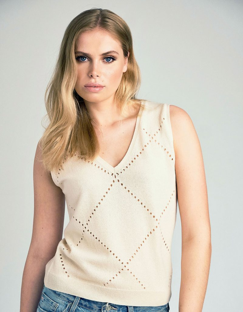 Studio shot of a model wearing a malin darlin cashmere jumper, the cream Katie vest style in womens cashmere.