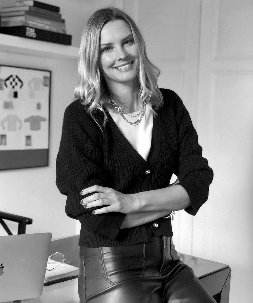 Portrait of a smiling Malin Jefferies, founder of malin darlin luxury cashmere knitwear.